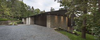 A Lakeside Retreat in Quebec Looks Sharp With a Blade-Like Roof - Photo 1 of 13 - A home designed by Quebec-headquartered studio MU Architecture