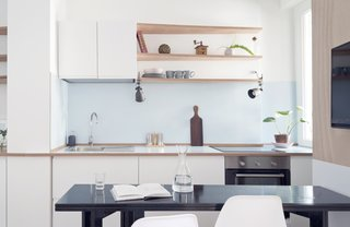 A Tiny Apartment in the Italian Riviera Takes Cues From Nautical Design - Photo 3 of 9 - A kitchenette and dining room