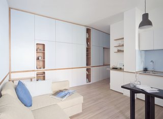 A Tiny Apartment in the Italian Riviera Takes Cues From Nautical Design - Photo 1 of 9 - When the doors are shut, the sleeping areas are completely concealed.