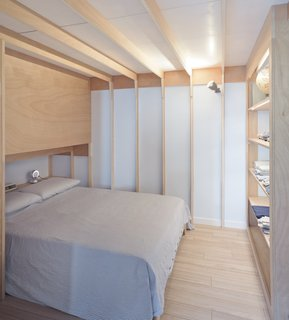 A Tiny Apartment in the Italian Riviera Takes Cues From Nautical Design - Photo 4 of 9 - The master bedroom has ribbed ceilings and walls that recall nautical frames.