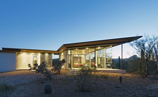 8 Glass Houses You Can Rent Right Now - Photo 1 of 8 - This house in Arizona's Sonoran Desert has concrete walls and floors and covered quartzite stone decks facing both the east and west.