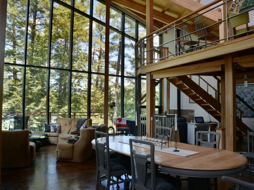 A home with tall glass walls near Lake Rosseau in Ontario, Canada.