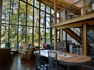 8 Glass Houses You Can Rent Right Now - Photo 8 of 8 - A home with tall glass walls near Lake Rosseau in Ontario, Canada