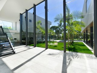 8 Glass Houses You Can Rent Right Now - Photo 6 of 8 - This holiday retreat in Cairns, Australia, has eight-meter-high glass windows and a 59-foot lap pool.