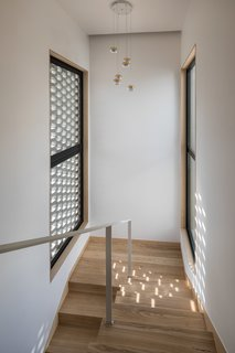 A Gabled Corridor Runs Through This Playful South Korean Home - Photo 12 of 13 - The staircase connecting the first and second floor
