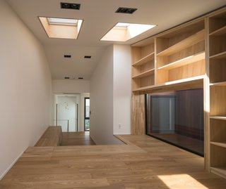 A Gabled Corridor Runs Through This Playful South Korean Home - Photo 11 of 13 - Skylights on the second level of the house