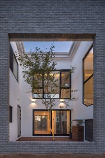 A Gabled Corridor Runs Through This Playful South Korean Home - Photo 8 of 13 - Located on the south side of the house is internal courtyard with a large rectangular section cut out from the southern exterior wall.