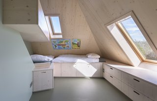 A Tent-Shaped Home in the Netherlands Crouches Between Natural Dunes - Photo 9 of 11 - Bunk beds and built-in storage in the attic