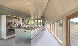 A Tent-Shaped Home in the Netherlands Crouches Between Natural Dunes - Photo 11 of 11 - The open plan kitchen on the ground floor