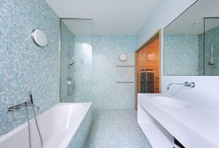 A Tent-Shaped Home in the Netherlands Crouches Between Natural Dunes - Photo 10 of 11 - A cheerful, blue, tiled bathroom
