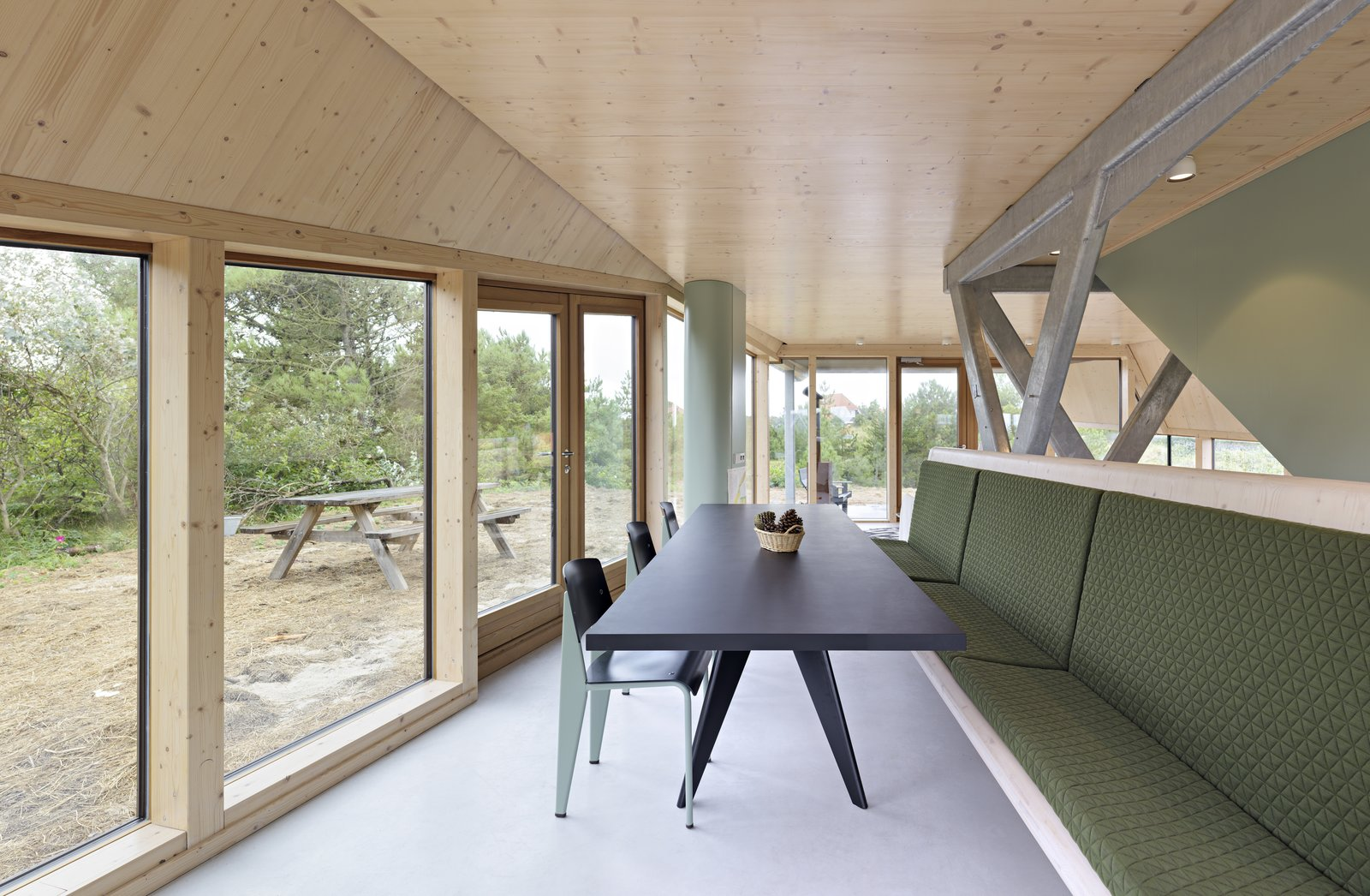 A dining table and bench that can accommodate the large family who use the summer home.