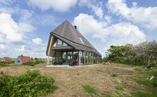 A Tent-Shaped Home in the Netherlands Crouches Between Natural Dunes - Photo 3 of 11 - The abode's high roof was inspired by the De Waard Albatross tent.