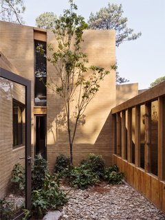 Five Cubist Hideaways Peek Out From a Mexican Pine Forest - Photo 7 of 17 - An interior courtyard