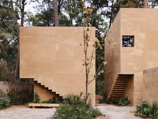 Five Cubist Hideaways Peek Out From a Mexican Pine Forest - Photo 8 of 17 - The interior staircases are cut out from the façade.