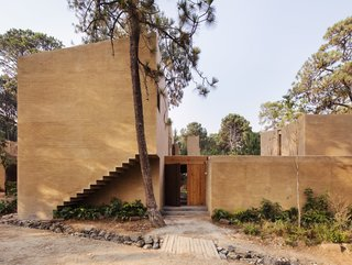 Five Cubist Hideaways Peek Out From a Mexican Pine Forest - Photo 1 of 17 - The entrance to the weekend home