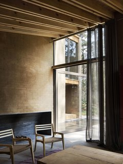 Five Cubist Hideaways Peek Out From a Mexican Pine Forest - Photo 6 of 17 - Full-height glass doors connects the living areas with the garden and forest outdoors.