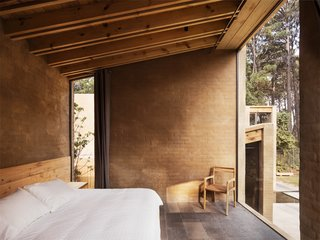 Five Cubist Hideaways Peek Out From a Mexican Pine Forest - Photo 2 of 17 - A sun-drenched bedroom on the ground level
