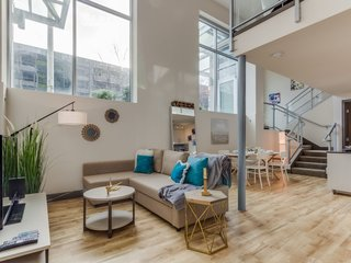 Live Large in These 10 Loft-Style Vacation Rentals - Photo 5 of 10 - This Seattle condo apartment has a mezzanine bedroom that looks down to the living area.