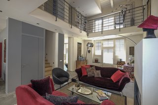 Live Large in These 10 Loft-Style Vacation Rentals - Photo 6 of 10 - This airy apartment is conveniently located near Milan's downtown, and offers four bedrooms, as well as gorgeous city views.