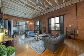 Live Large in These 10 Loft-Style Vacation Rentals - Photo 1 of 10 - This vacation apartment in Dallas, Texas, has 17-foot-high ceilings and exposed brick walls.