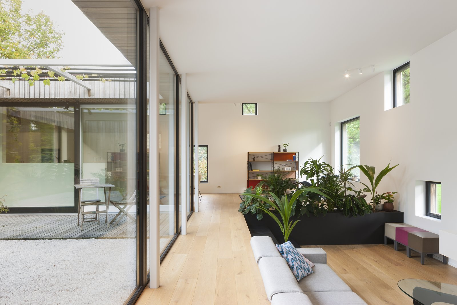A completely glazed inner courtyard ensures that the home is flooded with light.