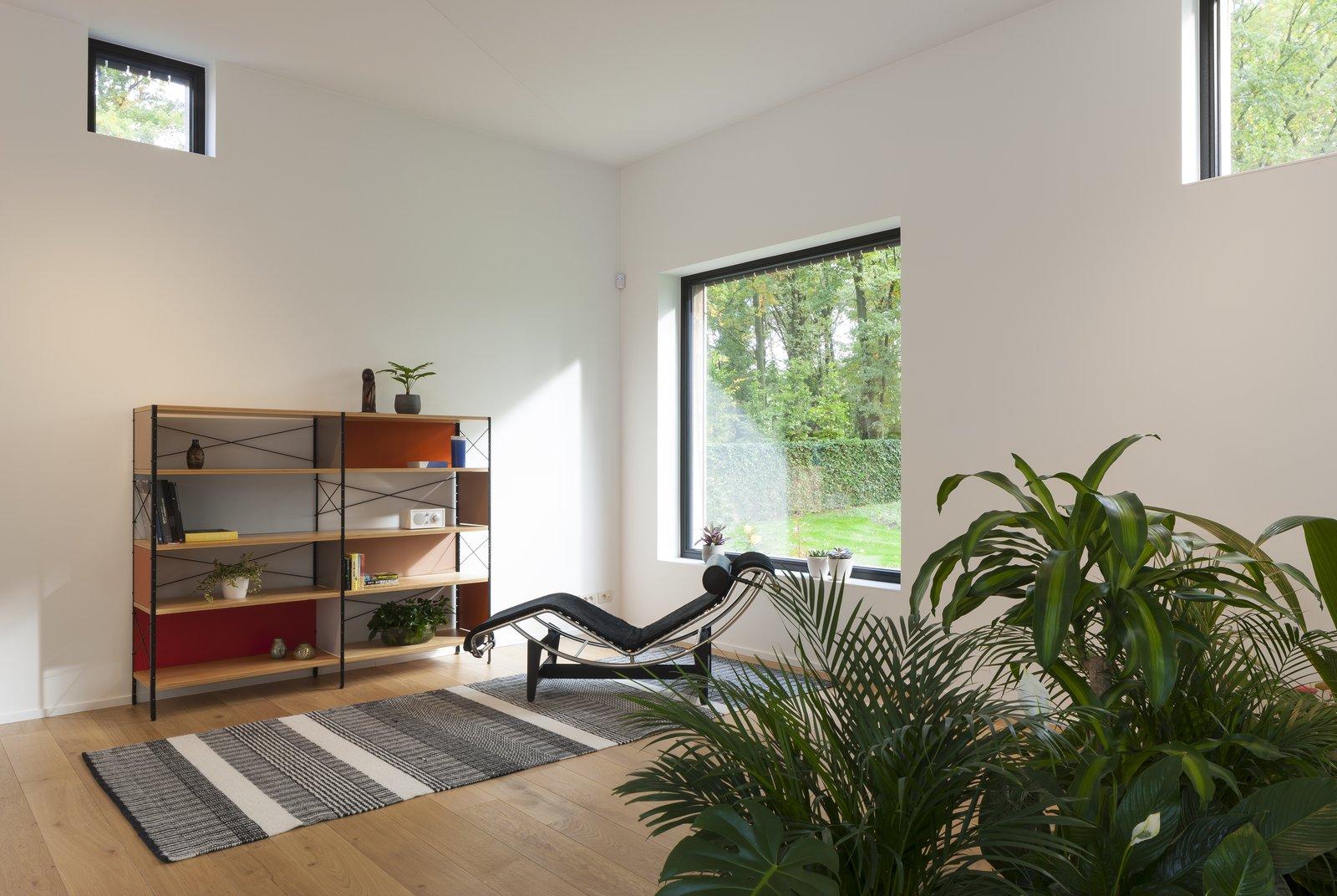 A black Arne Jacobsen Series 07 chair from Fritz Hansen, Eames storage shelf from Vitra.