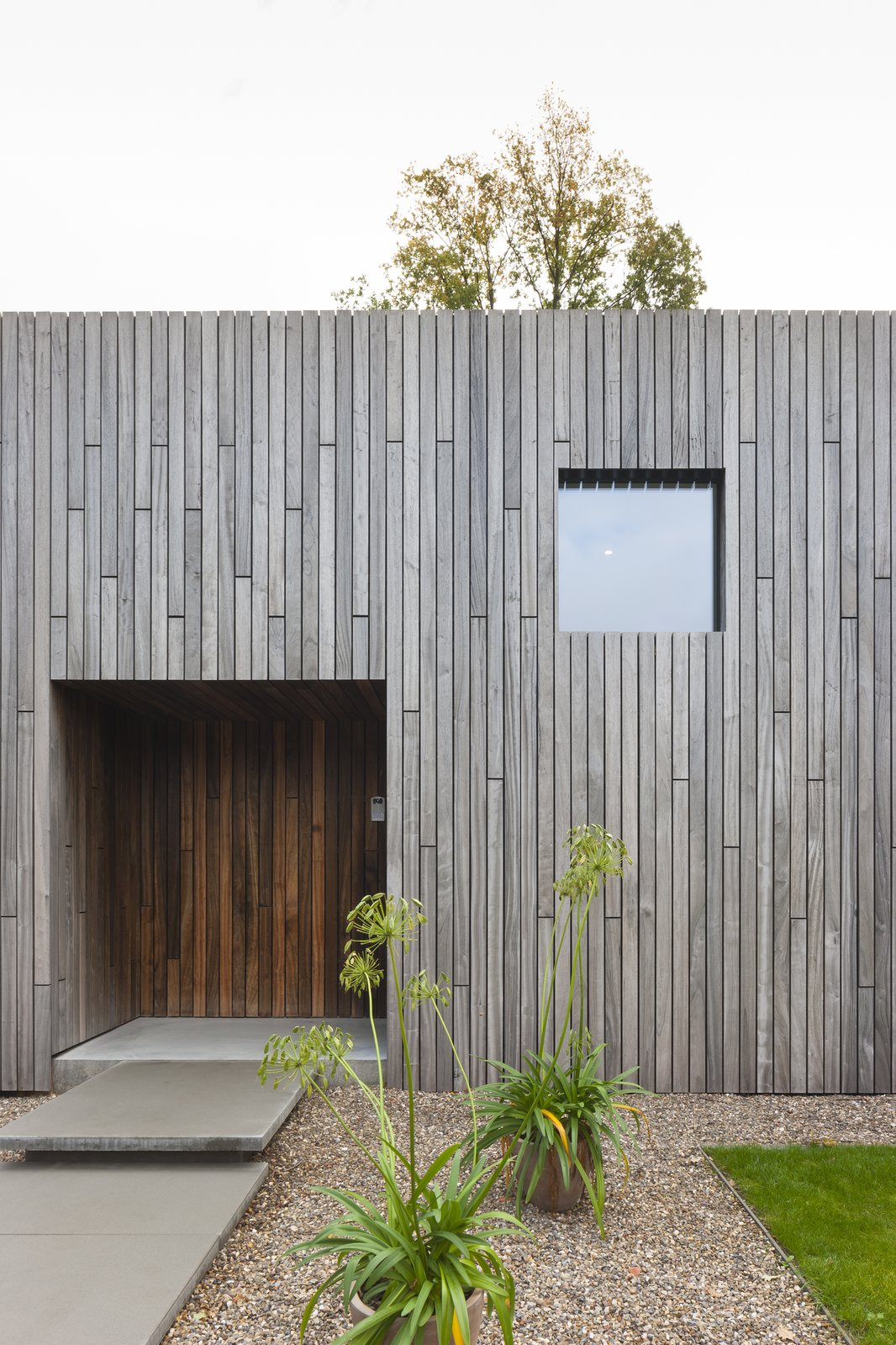 Like the windows, the front door is also a square.