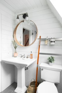 Before and After: An A-Frame Cabin Boasts Serious Scandinavian Vibes - Photo 9 of 14 - The bathrooms feature Kohler Brockway sinks.