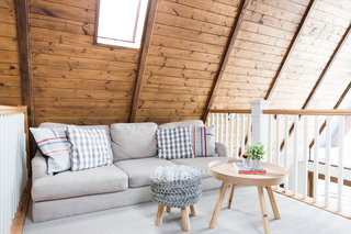Before and After: An A-Frame Cabin Boasts Serious Scandinavian Vibes - Photo 12 of 14 - A lofted lounge area