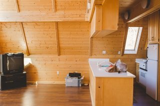 Before and After: An A-Frame Cabin Boasts Serious Scandinavian Vibes - Photo 2 of 14 - Before: the kitchen