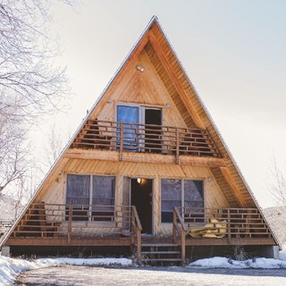 Before and After: An A-Frame Cabin Boasts Serious Scandinavian Vibes - Photo 1 of 14 - Before: exterior