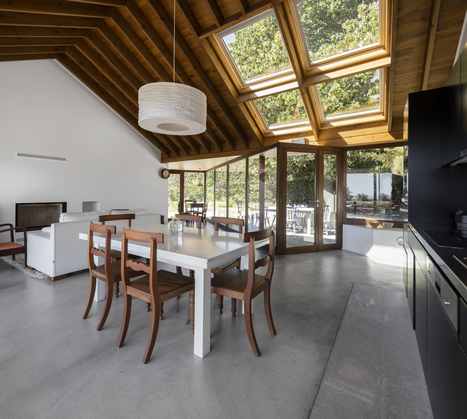 A simple, open plan living, dining and kitchen area that almost feels like part of the courtyard outdoors.