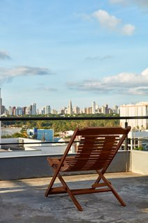 This Slender Concrete Home in Brazil Feels Like an Urban Jungle - Photo 12 of 13 - The house sits at an elevated position, offering great views of the city.