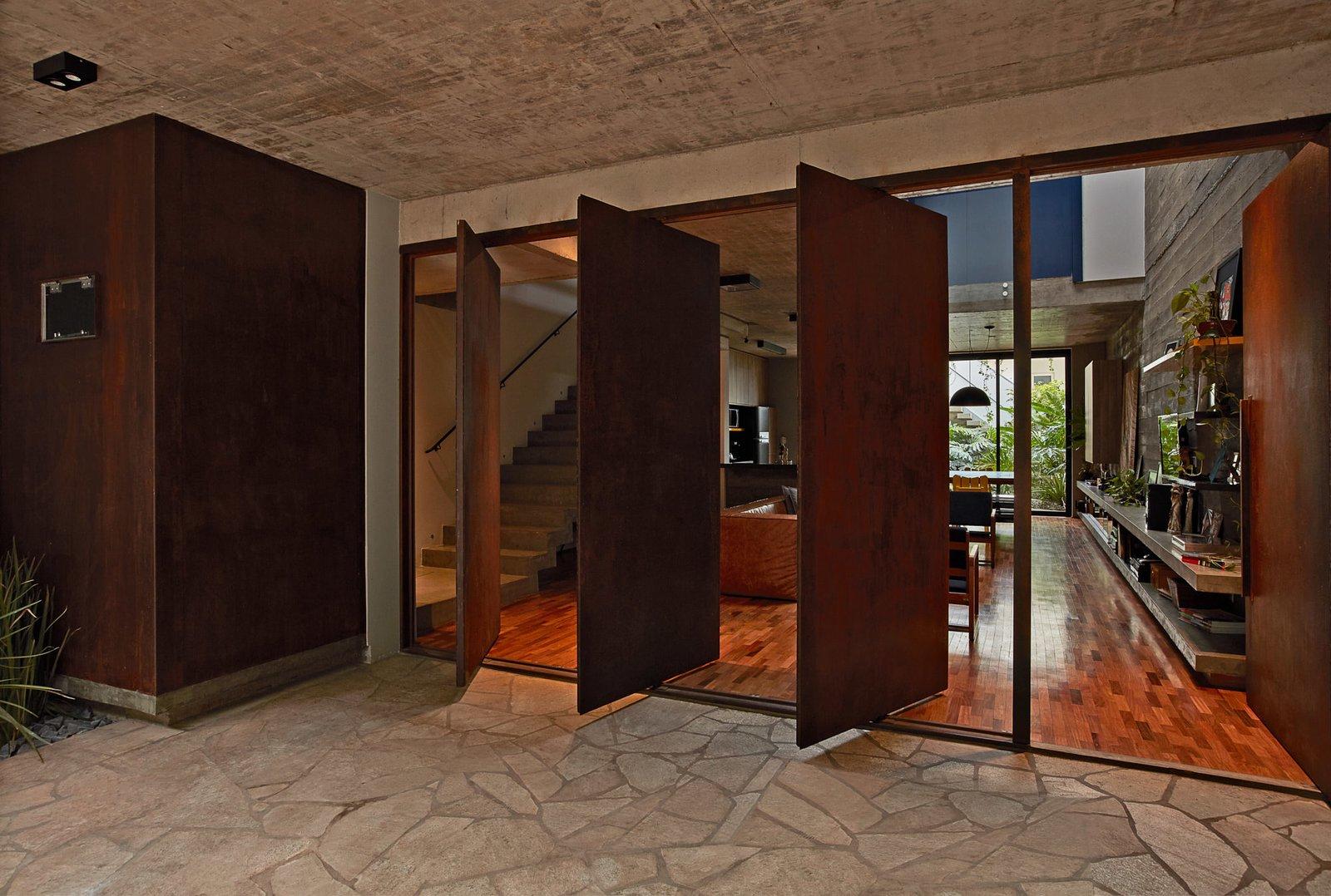 Four, pivoting Corten-steel doors help with cross ventilation.