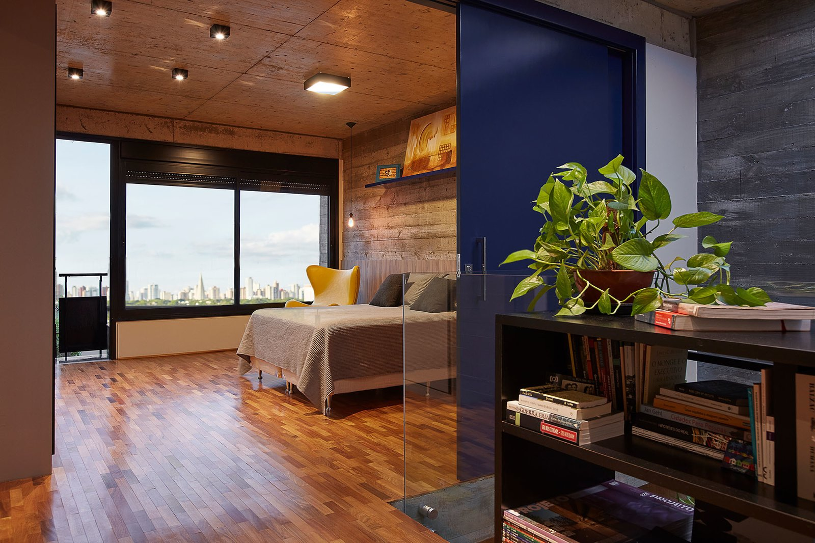 The master bedroom looks out to city views.