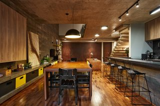 This Slender Concrete Home in Brazil Feels Like an Urban Jungle - Photo 6 of 13 - The dining and kitchen on the ground floor.