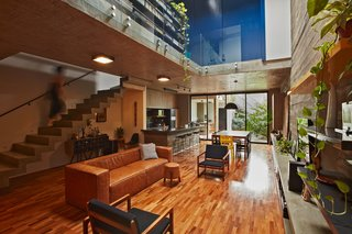 This Slender Concrete Home in Brazil Feels Like an Urban Jungle - Photo 1 of 13 - Stairs lead up to the upper level.