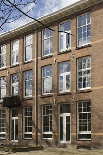 A 20th-Century Dutch Schoolhouse Now Holds a Series of Airy Lofts - Photo 1 of 13 - A school in Rotterdam that was built in 1912 was converted into six apartments.