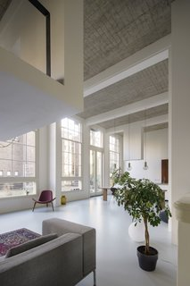 A 20th-Century Dutch Schoolhouse Now Holds a Series of Airy Lofts - Photo 3 of 13 - Over 16-foot-high ceilings allowed for the creation of new intermediate floors and intimate mezzanines.