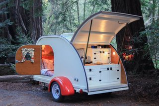 10 Cool Trailers and Campervans You Can Rent For Your Next Adventure - Photo 1 of 10 - With a comfy bed, a built-in kitchenette and plenty of storage, this tiny trailer will provide all the amenities needed for a quick getaway.
