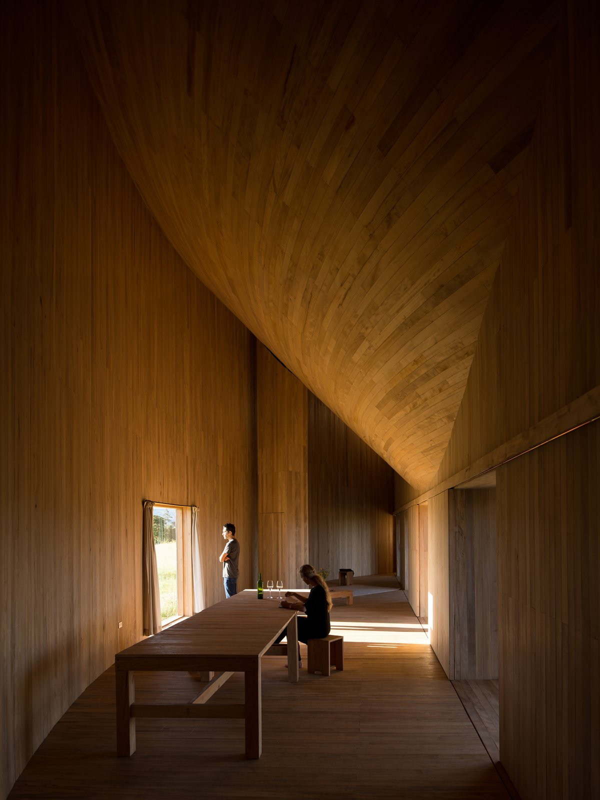 In the mid-section of the arc, is a simple living and dining space.