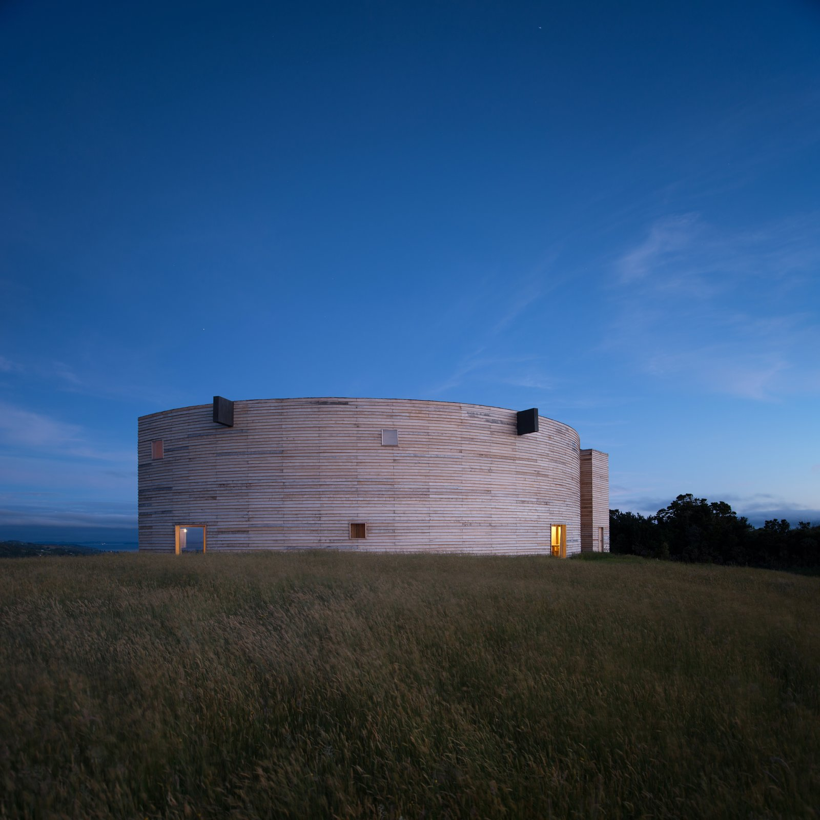 The 2,000-square-feet house has an enigmatic form that resembles a cylinder, cut in half along its diameter.