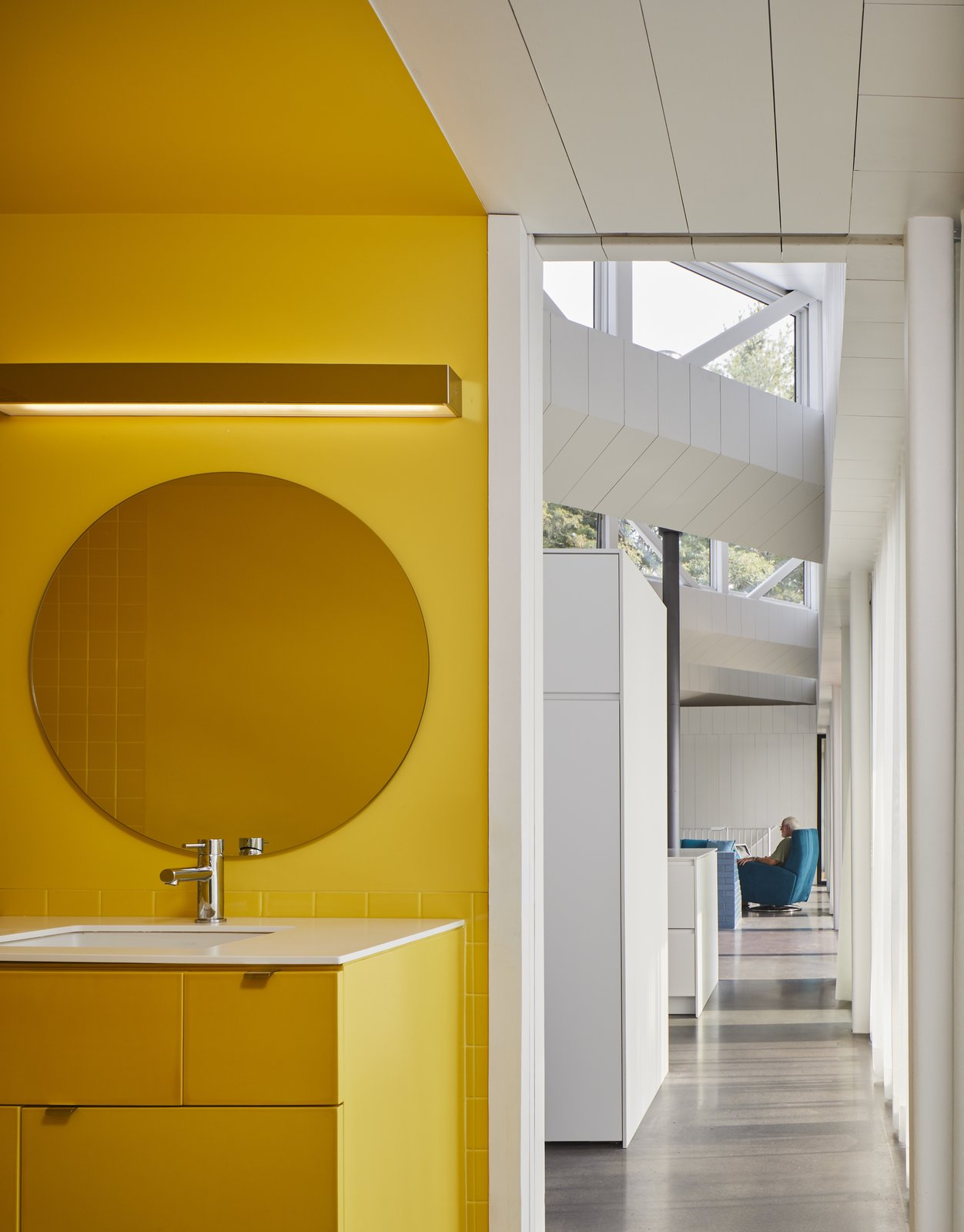 A cheerful yellow bathroom.
