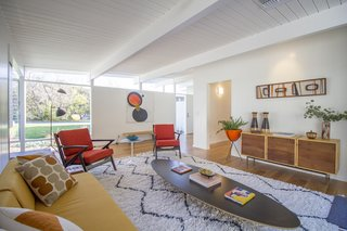A Meticulously Updated Midcentury in L.A. Asks $1.49M - Photo 7 of 12 - A lounging den features bright pops of color.