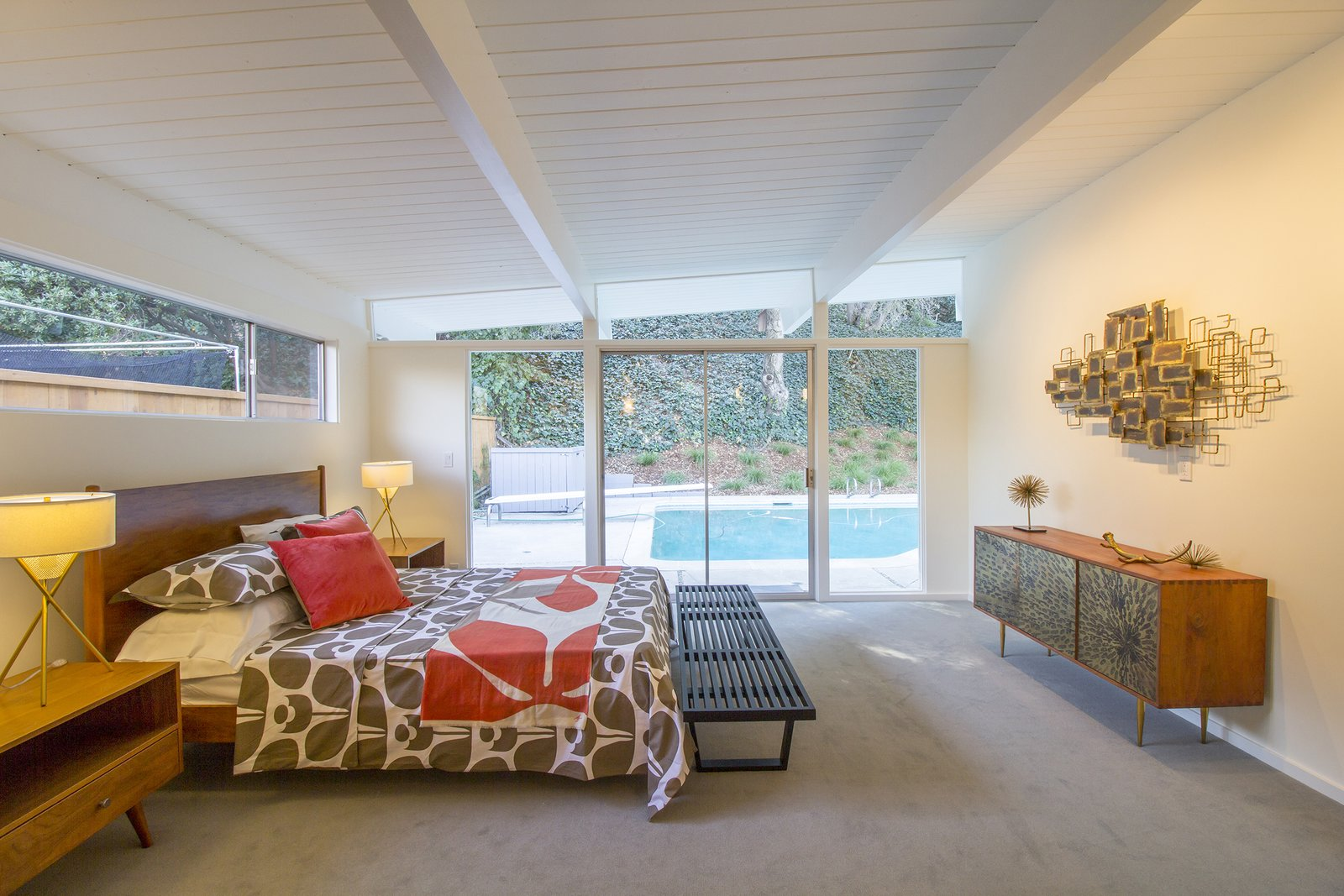 The owners can access the pool in the backyard via sliding doors in the master bedroom.