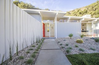 A Meticulously Updated Midcentury in L.A. Asks $1.49M - Photo 2 of 12 - The entrance to the house