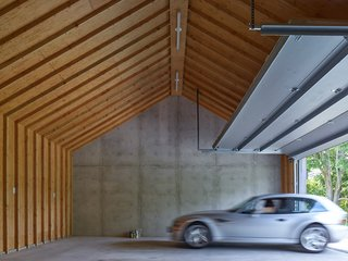 This Stunning Suffolk County Home Brings a Modern Twist to a Historic Area - Photo 6 of 18 - Here you can see the garage behind the concrete wall.