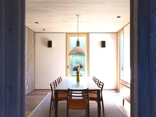 This Stunning Suffolk County Home Brings a Modern Twist to a Historic Area - Photo 11 of 18 - The owners also chose a suspension lamp by Fontana Arte to hang over the dining table.