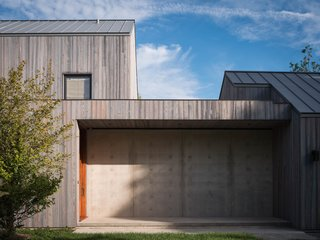 """This Stunning Suffolk County Home Brings a Modern Twist to a Historic Area - Photo 1 of 18 - This house on the """"Lanes"""" was designed with concrete foundational walls, charred siding, and VMZinc zinc roof."""