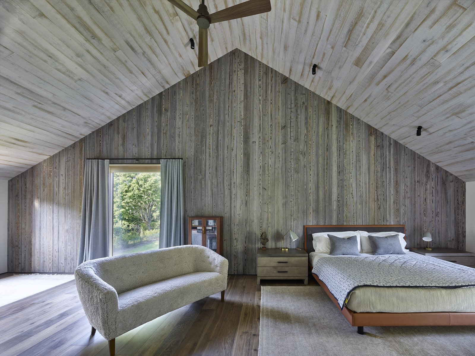 """A porch and roof """"cut-out"""" separates the parent's bedroom on one end from the two children's bedrooms on the opposite ends."""